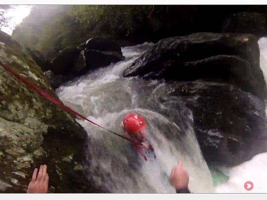 Kayaker caught under rock rescued