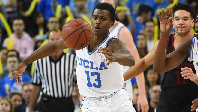 UCLA Bruins guard Kris Wilkes (13) reaches for a loose ball in the second half against the Stanford Cardinal at Pauley Pavilion.