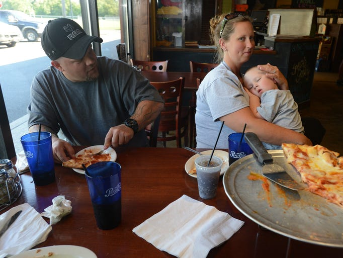 Colby Sauage, left, parents of a team member of the Maryland Express, eats dinner with his wife, Trisha Sauage and 3 year old son, Colton Sauage, while at Specific Gravity Restaurant.