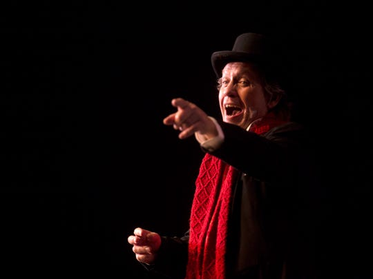 "Joel Irvin plays Ebeneezer Scrooge during a performance of ""A Christmas Carol"" on Thursday in the Little Theatre at San Juan College in Farmington."