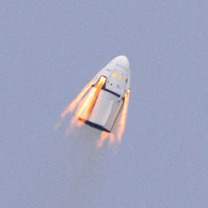 The SpaceX Dragon crew capsule and trunk blasts into