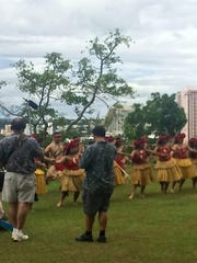 A film crew records Chamorro dancers for a documentary series for the National Endowment for the Arts.