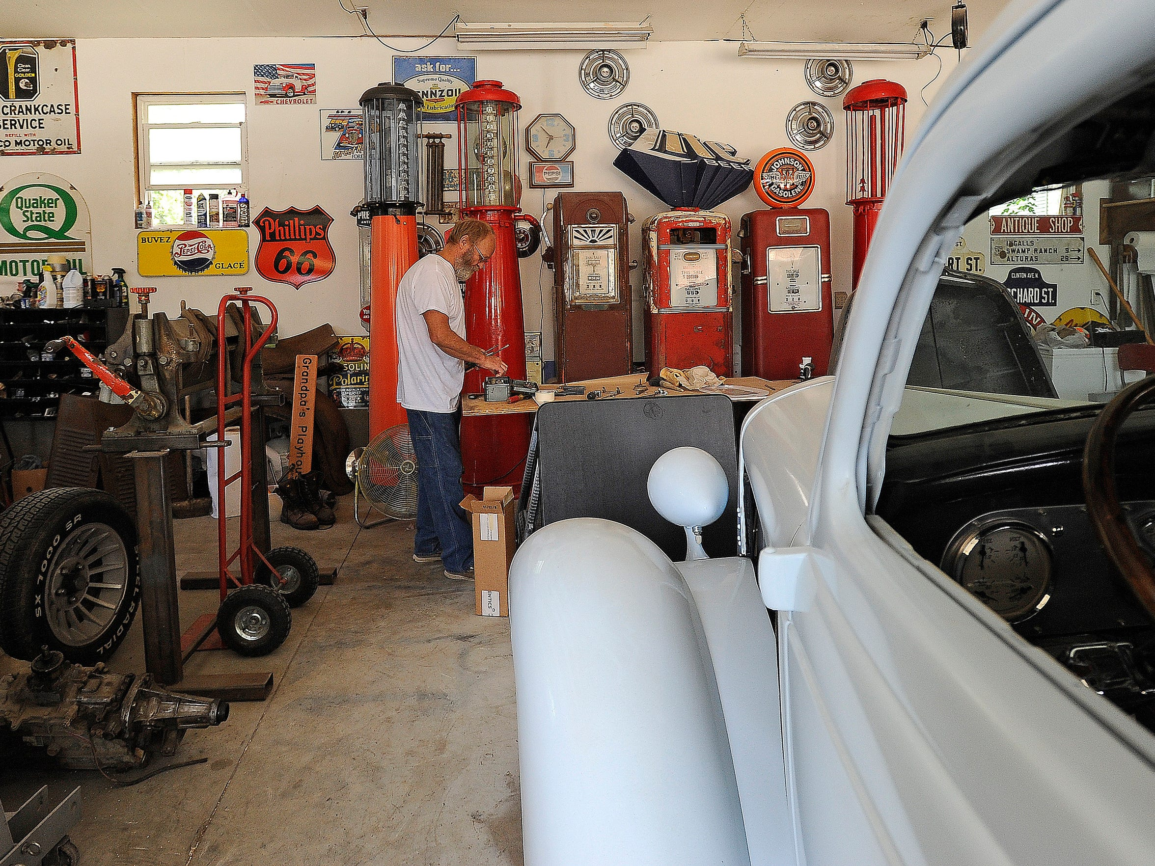 Dennis Johnson, 63, organizes his garage in the Whittier neighborhood in Sioux Falls, S.D., Thursday, July 9, 2015. Johnson moved to his home one month ago.