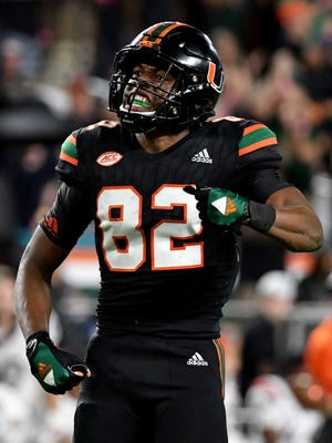 Ahmmon Richards (82) and the Miami Hurricanes have won the ACC Coastal title.