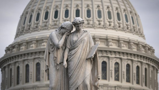 The Capitol Dome looms behind the Peace Monument statue in Washington, Jan. 23.