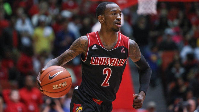 Feb 5, 2014; Houston, TX, USA; Louisville Cardinals guard Russ Smith (2) brings the ball up the court during the first half against the Houston Cougars at Hofheinz Pavilion. Mandatory Credit: Troy Taormina-USA TODAY Sports