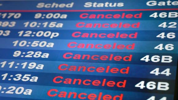 Screens display cancelled flights at Newark Liberty