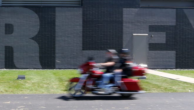 A pair of bike enthusiasts ride over to the Harley-Davidson Museum during the 2016 Milwaukee Rally.