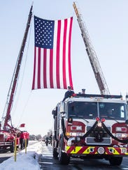A fire truck, leads the Funeral Procession for Lt.