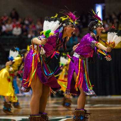 Cedar competes in the character category at the State Drill Team Finals at Utah Valley University, Saturday, Feb. 6, 2016.