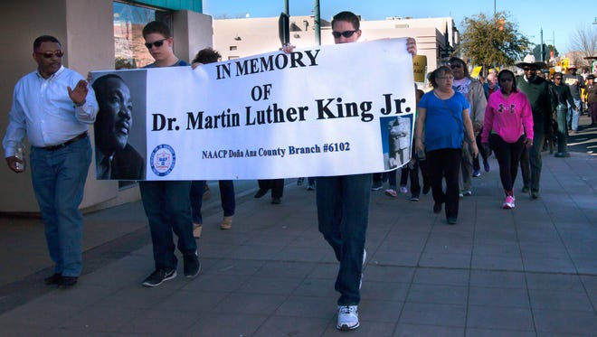 Members of the public join together for a peace march along Main Street during the 2017 Dr. Martin Luther King Jr. March in Las Cruces.
