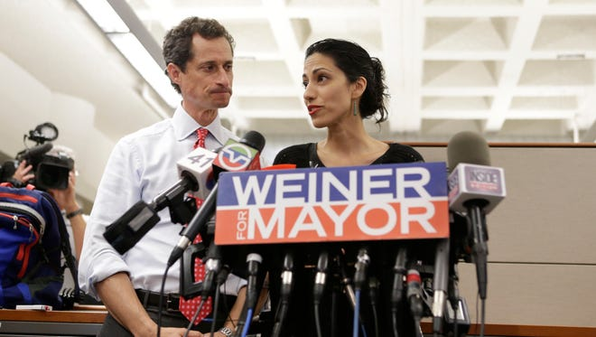New York mayoral candidate Anthony Weiner glances at his wife, Huma Abedin, as she speaks during a news conference on July 23 in New York.