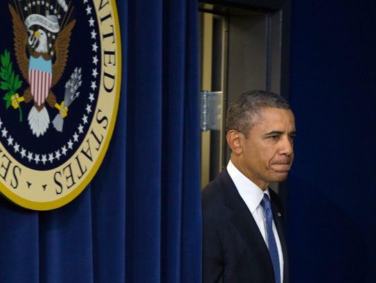 President Obama arrives to speak at White House on