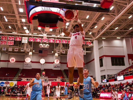 Austin Peay's guard Dayton Gumm, 4, dunks against Oakland