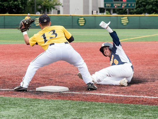 Robert Jeans (8) of TRN is safe at thirs as Monmouth's