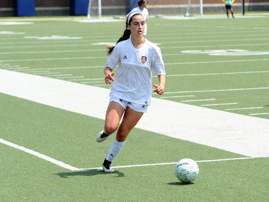 Wylie midfielder Gracie McCaslin (4) brings the ball