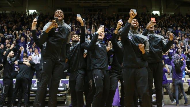 Northwestern celebrates on Selection Sunday.