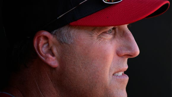 Reds manager Bryan Price looks on from the dugout during a loss to the Rangers on Monday.