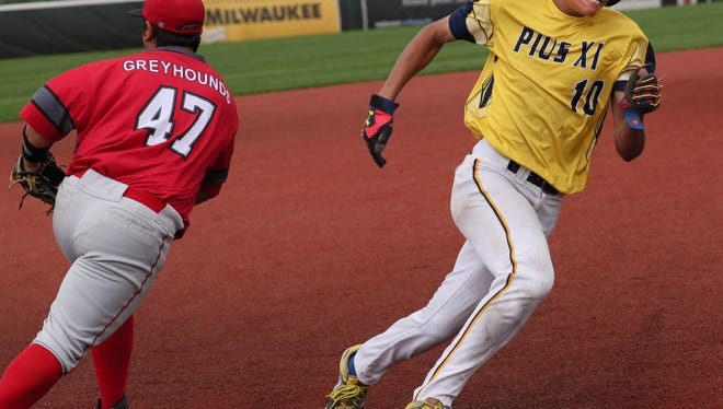 Reyshawn Sprewer rounds third base on his way to scoring for Pius against Shorewood on Thursday.