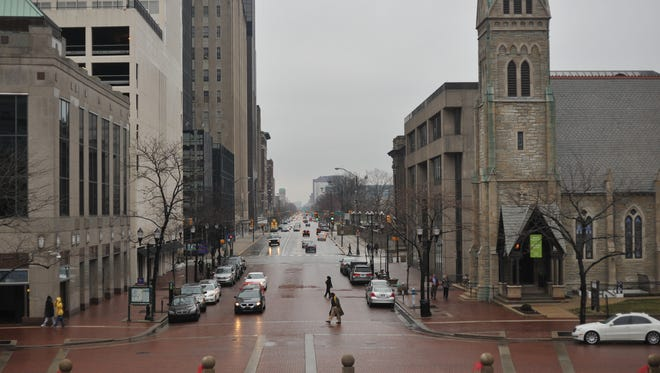 Church Cathedral, shown at right in downtown Indianapolis, says in a lawsuit filed Aug. 13, 2014, that JPMorgan Chase and Co.'s management of trust funds cost the church about $13 million.