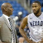 Nevada basketball coach David Carter chats with point guard Deonte Burton during their game against Nebraska-Omaha at Lawlor Events Center on Dec. 14. Omaha won 82-80.