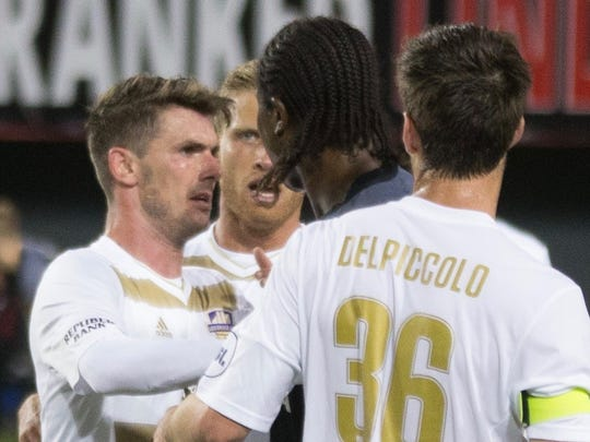 Louisville City FC's Niall McCabe, left, and FC Cincinnati's Djiby Fall get into an altercation during a match April 22, 2017 at Nippert Stadium. Louisville City coach James O'Connor alleged that Fall bit McCabe.