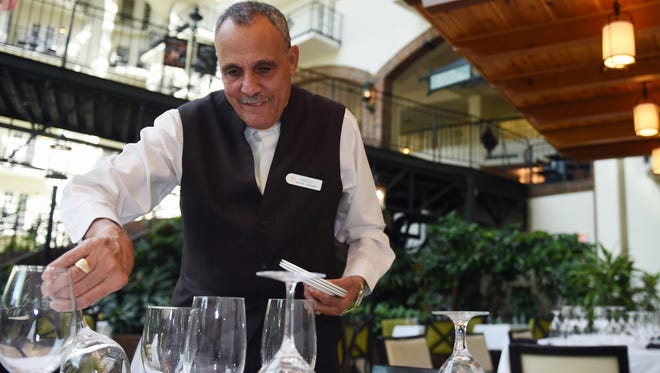 Gaylord Opryland Resort & Convention Center employee Hamby Mekhaeil prepares tables at Ravello on Thursday,  Oct. 22, 2015.