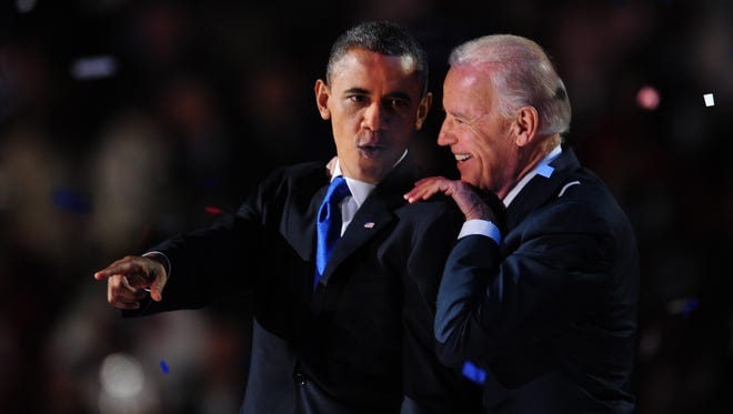 President Barack Obama and Vice President Joe Biden celebrate on stage after winning the 2012 presidential election on Nov. 7, 2012, in Chicago.  Obama swept to a emphatic re-election win over Mitt Romney.