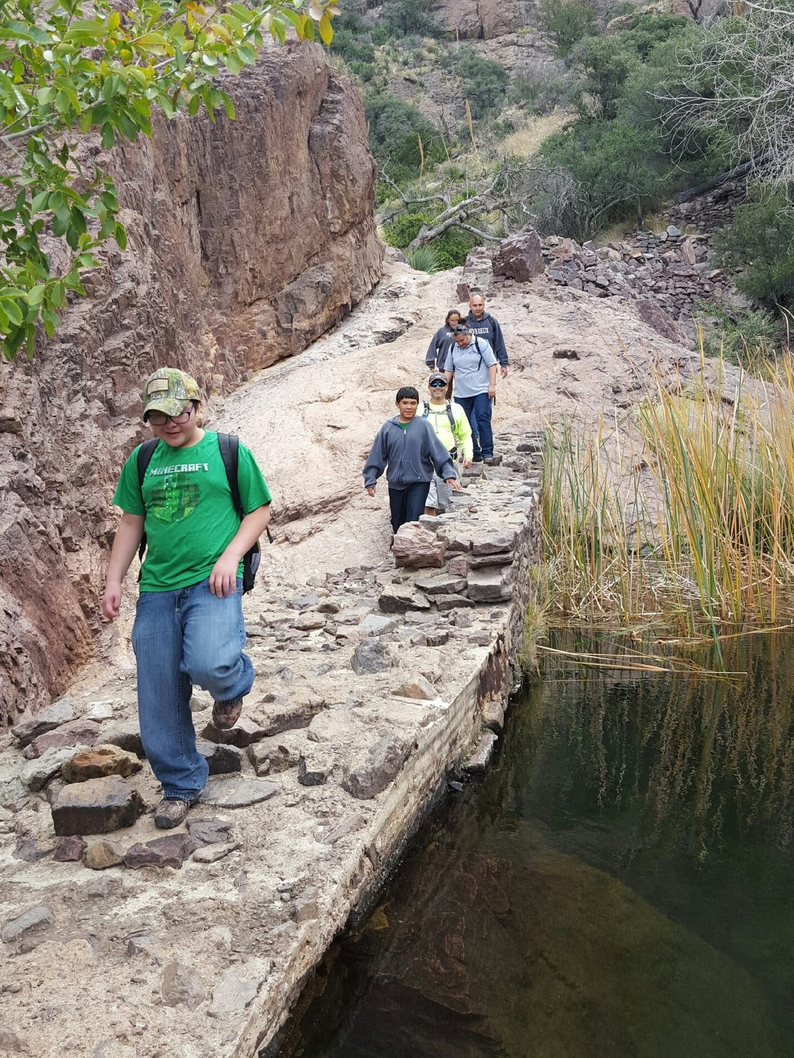 Kids hike a trail in Dripping Springs Natural Area