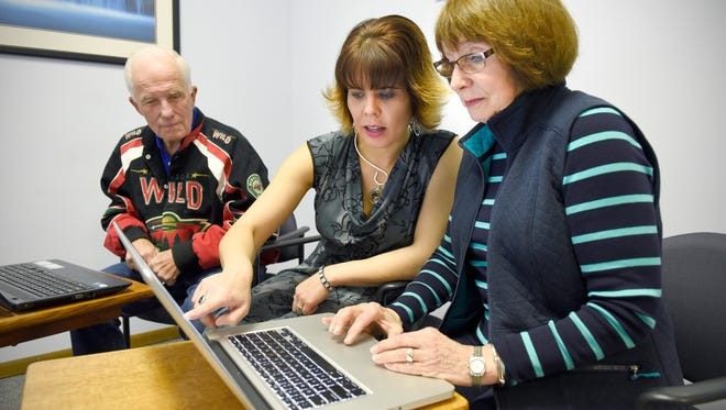 Richard Torrence and his wife Joanne Clepper, right, get help updating and checking for viruses on their computers from Katie Hultquist on Tuesday, Nov. 10, at Computer Renaissance.