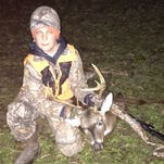 "Sawyer Stewart, 11, took this 8 point buck in January, shooting a .243, while hunting on family property in Forrest County. The buck had an 18"" main beam with a 15"" spread. This was Sawyer's first buck."