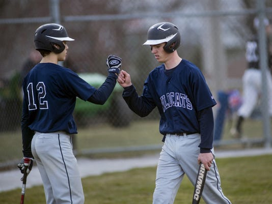 Dallastown's Joe Capobianco, left, congratulates teammate Riley Hamberger as he comes in from the field on April 2 against South Western. South Western won the contest, 13-6.