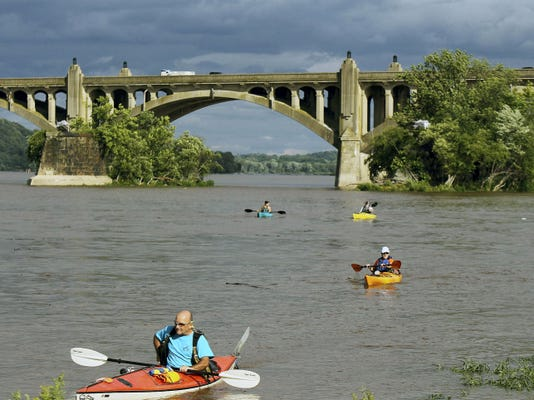 Kayakers stop in to enjoy the festivities during the 12th annual Riverfest at the John Wright Restaurant in Wrightsville Sunday June 28, 2015.
