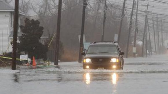 A high tide and a coastal storm caused flooding in Manasquan in this 2013 file photo.