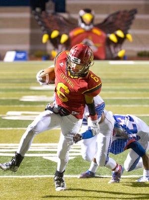 Centennial's Junior Pena gets through the Las Cruces secondary for a touchdown during the first quarter Friday night at the Field of Dreams.