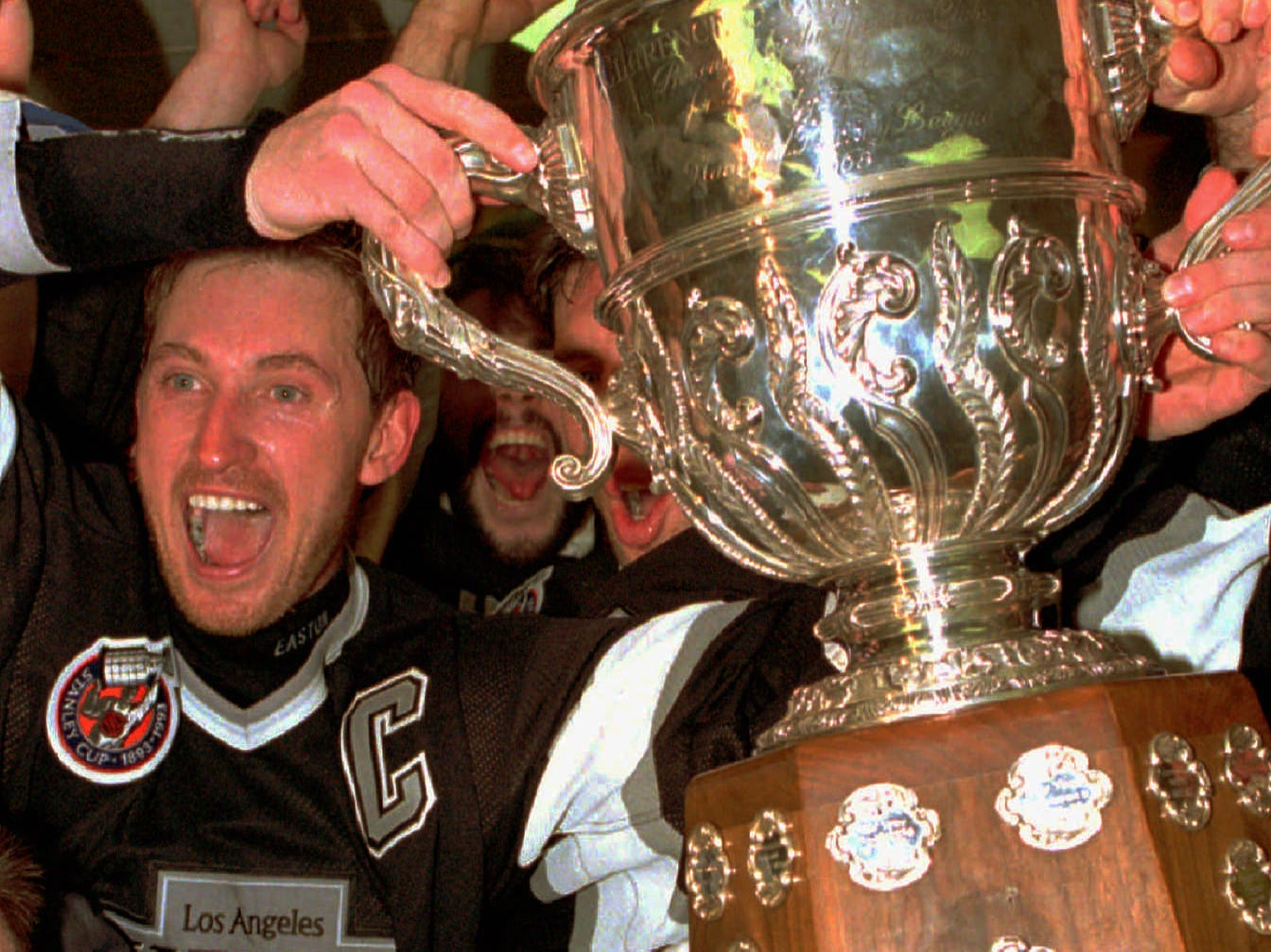 Gretzky made the Kings a must-have ticket, particularly during their run to the Stanley Cup Final in 1993. Gretzky holds up the Clarence Campbell Trophy, though the Montreal Canadiens won the Stanley Cup that spring.