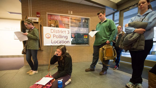 Same-day registration voters wait in line to cast their ballots at The Encore at Dreyfus University Center, which is the polling place site for District 3 in Stevens Point, Tuesday, April 5, 2016.