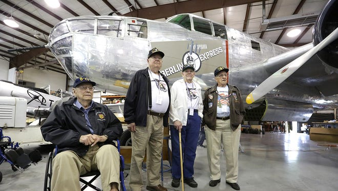 Four WWII veterans from the 345th Bomb Group stand next to a B25 plane at the EAA grounds Saturday, August 27, 2016. The group was at EAA to visit a 345th Bomb Group display. Veterans from left to right are Orville Schmidt, Roger Lovett, Linck Grush and Quentin Stambaugh. Doug Raflik/USA TODAY NETWORK-Wisconsin
