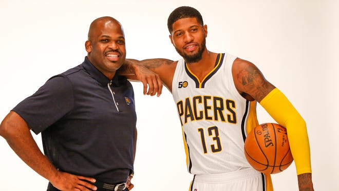 Indiana Pacers head coach Nate McMillan and Indiana Pacers forward Paul George (13) smile for a portrait during media day at Bankers Life Fieldhouse on Sept. 25, 2016.