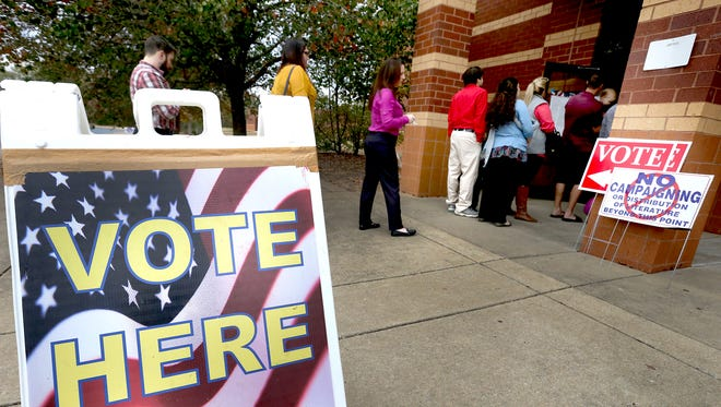 Voters are lined out the door to vote early on Election Day Tuesday, Nov. 8, 2016, at Barfield Elementary in Murfreesboro.