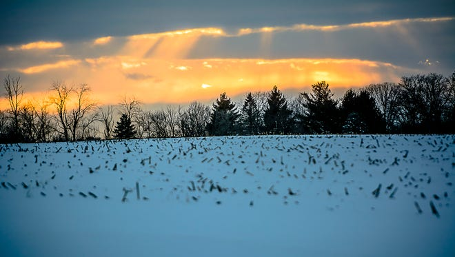 A field wrapped in winter snow at Fogle Farms.