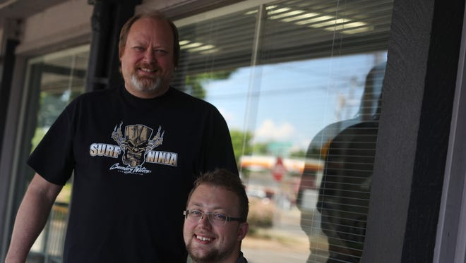 Boundary Waters Screenprinting owner Michael Karns, left, and his son Trevor, manager of the store, run the family screen printing business in Redding.