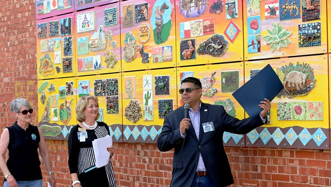 WIchita Falls Mayor Stephen Santellana talks about the Arts for All mural in downtown Wichita Falls before proclaiming June 24, 2017 as Arts for All Mural Dedication Day during Saturday's Art and Soul Festival.