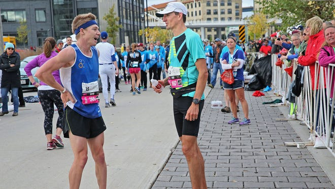 PNC Milwaukee Marathon winner Tyler Sigl of Seymour, Wis., right, compares notes with second-place finisher David Luy of Brookfield, Wis. Unofficial times were 2:20 for Sigl and 2:23 for Luy.
