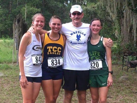Wakulla cross country coach Paul Hoover with former