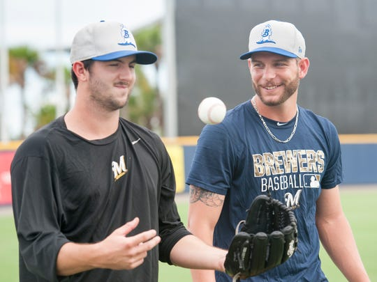 West Florida High School grad and current Biloxi Shuckers pitcher Brett Lee, right, and teammate Tyler Spurlin walk off the field after warming up prior to the Shuckers vs. Blue Wahoos baseball game at Blue Wahoos Stadium in Pensacola, FL on Tuesday, July 12, 2016.