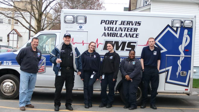 Port Jervis Mayor Kelly Decker, left, a volunteer ambulance driver, poses with members of the Port Jervis Volunteer Ambulance Corps.