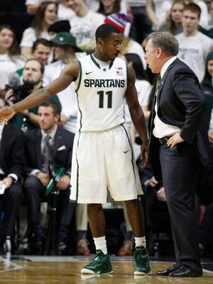 Michigan State's Lourawls 'Tum Tum' Nairn talks with head coach Tom Izzo during a break against Illinois on February 7, 2015 in East Lansing.