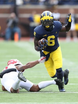 With Kareem Walker, seen here against Rutgers, and Chris Evans, the Wolverines have plenty of young depth in their backfield, but they're looking to add talent.