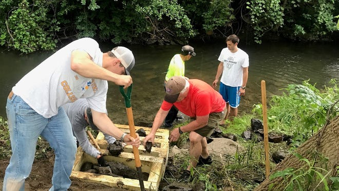 Recently, the Vanguard Chapter of Michigan's Trout Unlimited completed two conservation projects on northern Oakland County's Paint Creek, including constructing a stairway to provide better access to the water.